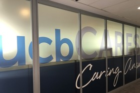 Wall with UCBCares printed on glass windows